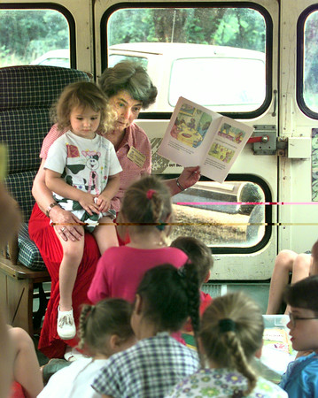 Date:   6/18/98---Emeline Johnson holds Kaylee Miller,3, in her lap as she reads to a group of kids on the Gilmer ISD Bookmobile at teh old Kelsey School. Kevin green