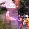 06/06/98--LFD firefihgters try to control a fully engulfed house fire Frioday afternoon at 314 Kenwood in Longview. Kevin green