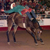 Date:   6/12/98---Chuck Logue from Decatur, TX rides Wild One during the barebackriding section of the Gladewater Round-Up Rodeo Friday night in Gladewater. Kevin green