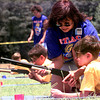 Date:   6/17/98---Carol Davis, of Hallsville gives Ryan Stephens,9, with pack 302 of Hallsville, some instructions at the bb gun range Wednesday afternoon during the day-camp for Cub Scouts at Pine Tree Junior High in Longview. Kevin green