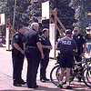 Longview Police officers confrencing after breaking up a fight at the basketball court at Alley Fest where one officer was bitten on the arm by a female combatent. Obie LeBlanc
