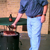 Date:   6/23/98---Darrell Marshall touches up a brisket with his homemade barbeque sauce, Texas Ranch House BBQ Sauce.  So far the product is in supermarkets in Dallas, Houston and several other parts of the state. Jessica Williamson