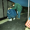 03/20/98--Mel and Carolyn Hardin look for the names of friends he lost while overseas at the Movin Wall Vietnam veterans' memorial currently at Rosewood Cemetery Friday evening. Matula photo.