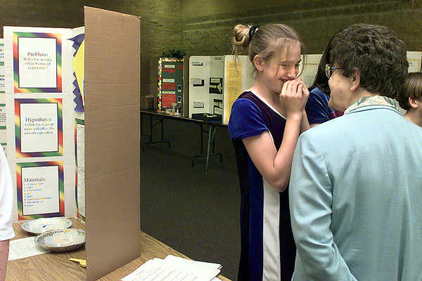 03/25/98--St. Mary's student Kate Brady, 12, gets a pep talk from Sister Jo Kasel, SSND (superintendant for schools in the Tyler Diocese) prior to judging of the school's science fair projects Wednesday. Matula photo.