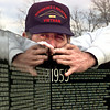 Date:   3/19/98--Tim Swearengin, of Houston, lines up the panels of the Vietnam War Memorial Wall during his 145 set-up, duing seven years of traveling with the wall, Thursday afternoon at Rosewood Cemetery outside of Longview. Kevin green