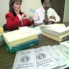 Date:   3/12/98---Paula Lawson, left, and Claude Andrews, right, prepare ballots for the Silver-Haired Legislature election. Kevin green