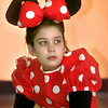 Date:   3/26/98--Minnie Mouse, played by Markie Buck, looks into the audience as she awaits her next song during the Disney Spectacular program Thursday afternoon at Pine Tree Intermediate School in Longview. Kevin green