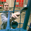 Kathryn Baney, a student at Longview High School, brings life back to the playground at Longview Child Development Center on High St., as the Leadership Tomorrow class renovate the playground, Wednesday morning in Longview, Kevin green