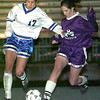 Date 3/13/98--- Pine Tree's # 17 battles for the ball with Lufkin's # 23 duirng the soccer playoff game Friday night at Pirate Stadium in Longview. Kevin green