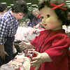 Karen Eitelman, left, of Hallsville, looks at one of the many booths at teh doll show Saturday afternoon at the Longview Fairgrounds in Longview. kevin green