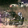 Date:   3/27/98---Kilgore rescue personal stand by and wait for the funeral home on I-20 just west of Longview Friday night after a two vehicle accident left one dead. kevin green
