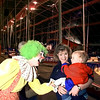 "03/17/98--Chase Dreher, 1, is greeted by ""Shenanigans"" the clown as mom Tracie Dreher has a laugh at the entrance of the big top at Carson & Barnes Circus Tuesday afternoon. The five ring extravaganza will be at the Longview fairgrounds through Wednesday night. Matula photo."