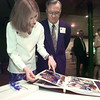 03/26/98--PTHS junior Sara Farris shows her grandfather Don Williams a scrapbook of important events Sara attended for Leadership Tomorrow at their banquet Thursday night. Matula photo.