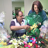 Date:   3/25/98---Dalton Wilson, left, gets a little help from Darlene Branum, right, the easter basket eggstravaganza chairperson, while making a bow on one of the many baskets the patients have been working on Wednesday morning at the Easter Seals office in Longview. Kevin green