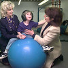 Date:   3/18/98---Beverly Butler Hall, left, and Patricia Hadley, right, work with T. J. in the pediactric gym Wednesday morning at the Therapy Center in Longview. Kevin green