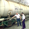 Bill Rasile, left, the Union Tank Car Company plant manager in Longview, visits with Russell Marshall, right, the LFD training officer, as they look over the newly donated tank car to the LFD dept. for use in training, Wednesday afternoon at the UP yard in LOngivew. Kevin green