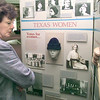 Jerry Anne Jurenka, president of Women in Longview, looks over the Texas Women in History display Friday afternooon at the Longview Public Library. Kevin green