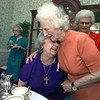 05/12/98--Frances Green, left, gets a hug from her former Bible study teacher Faye Field, religious author and widow of T.G. Field, during a 50th reunion for the Heritage Bible Study Club in Longview on Ttuesday. Matula photo.