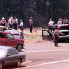 Date:   5/7/98----Police authorities secure a shooting scence where a bank robber ended his chase from police Thursday afternoon on Texas 31 just south of I-20 near Kilgore. kevin green