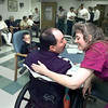 05/01/98--Derek and Mary Hunter share a private moment together before the start of his going away party at Breezeway Nursing and Rehabilitation Home in Gladewater Friday afternoon. Derek was diagnosed with 80% brain stem damage last June after a severe hemorrhage, but is returning home after a legnthy recovery. Matula photo.