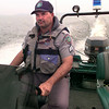 Date:   5/14/98---Texas Game Warden Mike Walker on Lake O Pines. Kevin green