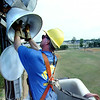 Scott Corley a senior lineman with SWEPCO replacing one of several light bulbs on poles as high as 70 feet Friday afternoon at Hinsley Park in Longview after SWEPCo donated the trucks and the SWEPCo employees donated time to save the city around 5,000 dollars in labor cost. Kevin green
