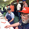 05/08/98--Don Mitchell, right, and Weldon Haywood play dominoes after sampling the Stroh's Brewery appreciation barbecue in the breakroom Friday. The employees were treated to the feast in gratitude for over 100 day without a lost-time injury. Matula photo.