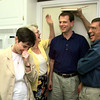 05/07/98--Heather Ross-Sirola, left, Jerre Jouett and Jerry Jouett, right, laugh as they put Tapio Sirola against a door they used to measure him 15 years ago. Sirola was a Finnish exchange student living with the Jouetts in the mid 1980s. He and his wife came to Longview because she has business in White Oak for the Finnish company she works for. Matula photo.