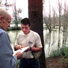 Date:   5/15/98--James Eitel, left, and Kollin Hurt, right, both board members of the Kelsey Creek Sanctuary on Lake Gilmer, and Kollin is also with Dean Lumber, look over a map while touring the spot of the sanctuary Friday morning in Gilmer. Kevin green