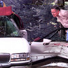 Date:   5/26/98---Doyle Morrow, a resident on McCann Rd. looks at the damage to a Buick Park Avenue that was broad-sided at McCann Rd. and Mockingbird Ln. Tuesday afternoon in Longview. kevin green