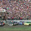Date:   4/5/98---NASCAR drivers take the green flag as the second Texas 500 gets underway April 5, 1998 at Texas Motor Speedway in Fort Worth over 200,000 were in attendance. Kevin green