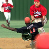 Date:   5/23/98----Carthage #7 tags Tearkana #17 out at second as he trys to steal during Saturday's game in Carthage. Kevin green