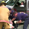 Date:   5/26/98---LFD fireman prepare ro transport an accident victim as another lady sits and waits with a neck brace on in her van after hiting a vehicle broad side Tuesday afternoon on McCann Rd. at Mockingbird Ln in Longview. kevin green