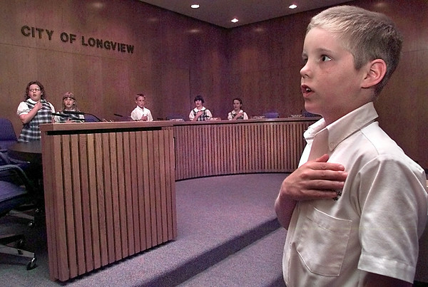 Date:   5/4/98----John Martin, a third grader at Trinity School of Texas pledges allegiance to the American flag during a mock city council meeting Monday afternoon at the City of Longview council chambers. Kevin green