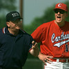 05/31/98--Carthage head coach takes his fruetrations out on the home plate umpire after several bad calls against Highland Park Saturday in Driller Park in Kilgore. Matula photo.