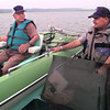 Date:   5/14/98---Layton Wright, left, of Harelton, visits with Texas Game Warden Mike Walker on Lake O Pines Thursday morning. Kevin green