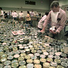11/24/98---Pete Morgan of Longview picks up cans of green beans to put into meal boxes at Tuesday's annual Thanksgiving Food Drive at the Maude Cobb Convention and Activities Center. bahram mark sobhani