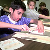 Date:   11/19/98--Parag Sevak, a fifth grader in Arlette Convington's class at Pine Tree Middle 5/6 campus, cuts his clay to make a tile as his design is on the table to the left, as the fifth graders toured the Longveiw Museum of Fine Arts Thursday morning in Longview. Kevin green