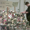 Date:   11/24/98---Stephen Smith packs a meal box made up of donated foods at the Maude Cobb Convention and Activity Center during Tuesday's Thanksgiving Food Drive. bahram mark sobhani