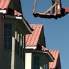 Date:   11/10/98---Miguel Angel Gomez looks down from his raised platform after touching up th paint on some Mexican-style roofing tiles on the Homewood Suites extended stay hotel. bahram mark sobhani