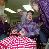11/18/98---Cecil Kennedy receives well-wishes for his 99th birthday from his friends Ruby Broome, right, and Jewel Von Cannon, left, at Grand Court Retirement Center. Kennedy attributes his longetivity to keeping busy. Lately, he has been busy crocheting lap blankets to be given away. bahram mark sobhani