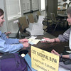 Date:   11/17/98---City National Bank VP Laurel La Rue, left, visits with Grand Court resident Doris Keating, right, at the mobile bank Tuesday afternoon at Grand Court in Longview. Kevin green