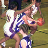 Date:   11/23/98---Hallsville's #25 takes the ball away from Spring Hill's #15 as Hallsville's #20 also blocks during Monday nights game in Hallsville. Kevin green