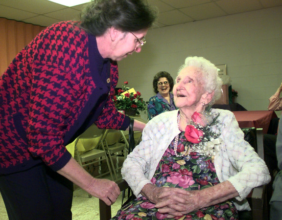 Date:   11/21/98----Mary Lynn Purifoy, left, of Baytown, visits wiht her grandmother Lola Stein as she celebrated her 100th birthday Saturday afternoon at the Summerfield United Methodist Church in Gregg County. Kevin green