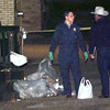 Date:   11/5/98---Rusk County crime investigators sort through garbage from a dumpster in the alley to the side of the bank as the investigation into the murder of a bank president Thursday night in Overton. Kevin green