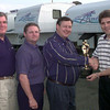 Date:   11/24/98---Left to Right---Mark Lane dist sales mgr, Rick Powell regional sales mgr, Bill Bockoven general mgr of Fleetwood Travel Trailers of Texas present and award to David Hayes the owner of Hayes Trailer Sales in Longview. Kevin green