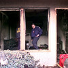 Date:   11/4/98----LFD firefighter ?????Curtis Young????? inspects his burned apartment Wednesday morning after a blaze at Summer Green Apartment complex on Judson in Longview. Kevin green