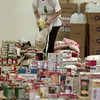Date:   11/19/98---Dawn Stanford stands amidst a mountain of food and supplies being collected as aid for hurrican-ravaged Hondurans. St. Michael and All Angels Episcopal and Trinity Episcopal churces are organizing the effort to aid the South American country. Donations will be received through Sunday at 1501 W. Cotton St., where it will be loaded up for delivery. bahram mark sobhani