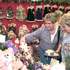 Date:   11/21/98---Jean Conaway, left, and Gloria Thomas, right, look at some of the items at teh K & C Country booth SAturday afternoon at Maude Cobb in Longview. Kevin green