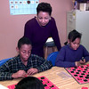 Date:   11/11/98-----South Ward Elementary pricipal Laura Bonner, looks over the shoulders of Marcellus Hayes, left, and Brittany Bush, right, two fifth graders as they compete in a checkers tournament in Frankie Bolton's class. Kevin green